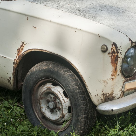 junk car with rust on body