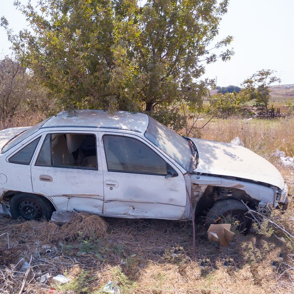 damanged and worn car