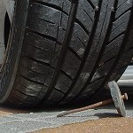 tire about to drive over nail