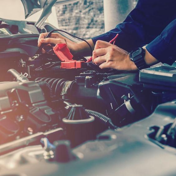 Mechanic testing failed car battery