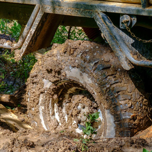 An Off-Road Vehicle Stuck in Mud.